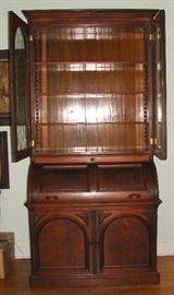 Antique secretary when empty.  It has four adjustable shelves.