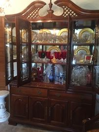 Made by Lenox, gold trim dinner plates, ruby red goblets, blue wine glasses and decanter, crystal dinners plates