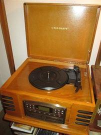 Crosley radio, phonograph, CD player, cassette player.