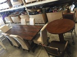 Dining tables and chairs. Former model home furnishings