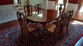 Dining Table / Chairs with a Nice Rug under