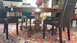 Baker Dining Room Table - currently round, can be extended to oval with matching leaves, included