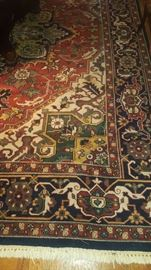 Hand-knotted in India 100% wood pile rug. Design Herize. Rust and Navy in color. 11.10 x 9.1