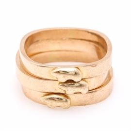Stacking 14K Yellow Gold Bear Fetish Rings: An assortment of stacking 14K yellow gold bear fetish rings. Each of these rings have a rounded square shank and a raised Native American inspired bear fetish on front.