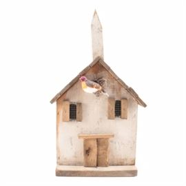 """Folk Art Decorative Wooden Birdhouse: A folk art decorative birdhouse. This piece is shaped like a house with a steeple on the roof, and two windows to the front with a bird perched between them. The piece is painted off-white, and has a decal to the underside marked """"Sophie's Treasures Primitive Folk Art Wood Accessories for the Home & Garden""""."""