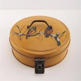 """Vintage Tin Pie Storage Container: A vintage tin pie storage container. This tin depicts birds on a limb to a yellow background with a handle to the top and a latch at the front. The piece is marked """"Germany"""" to the underside."""