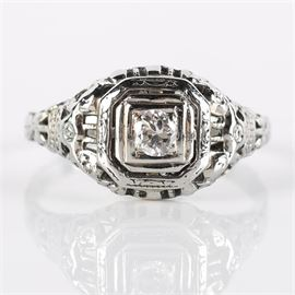 Late Edwardian 18K White Gold and Diamond Ring: An 18K white gold late Edwardian diamond ring set in a pierced octagonal frame.
