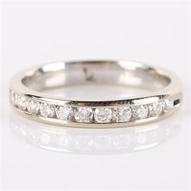 14K White Gold Channel Set Diamond Band: A 14K white gold and channel set diamond band.