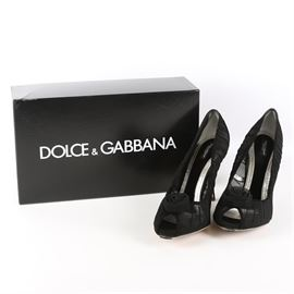 Dolce & Gabbana Black Tulle Pumps: A pair of Dolce & Gabbana peep toe pumps in size 41. This style features a pleated sheer black tulle upper with a rosette accent at the toe. The shoes come in the original box with a dust bag.