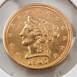 1907 $2 1/2 Liberty Gold Coin: A 1907 $2 1/2 Liberty gold coin. Designer: Christian Gobrecht. Mintage: 336,294. Metal Content: 90% gold 10% copper. Diameter: 18.0 mm. Weight: approximately 4.18 grams. Very good condition.