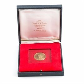 1974 18kt President Gerald Ford Gold Inaugural Medal: A 1974 18kt gold inaugural medal. This medal depicts a bust of President Gerald Ford on the obverse with a quote and date of inauguration on the reverse. The medal comes in a blue vinyl presentation box with red interior. Good condition.