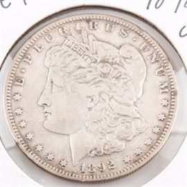 Low Mintage 1892 S Silver Morgan Dollar: A low mintage 1892 S silver Morgan dollar. Designer: George T. Morgan. Mintage: 1,200,000. Metal content: 90% silver, 10% copper. Diameter: 38.1 mm. Weight: approximately 26.7 grams. Circulated. Good condition.