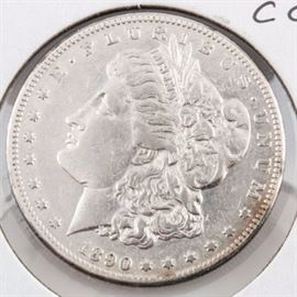 1890 CC Silver Morgan Dollar: An 1890 CC silver Morgan dollar. Designer: George T. Morgan. Mintage: 2,309,041. Metal content: 90% silver, 10% copper. Diameter: 38.1 mm. Weight: approximately 25.9 grams. Circulated. Fair condition. The coin appears to have been cleaned.