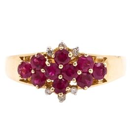 14K Yellow Gold Ruby and Diamond Ring: A 14K yellow gold ruby and diamond ring. This ring features ten rubies to the center with six round brilliant cut diamond accents to the top of the ring.