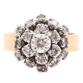 14K Yellow Gold 0.50 CTW Diamond Ring: A 14K yellow gold 0.50 ctw diamond ring. This ring features prong set diamonds arranged in a clustered floral motif with a hexagonal halo.