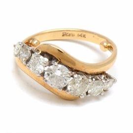 Vintage 14K Yellow Gold Diamond Ring: A vintage 14K yellow gold diamond ring composing 1.51 ctw in round brilliant cut diamonds.