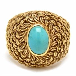18K Yellow Gold Turquoise Woven Ring: An 18K yellow gold turquoise woven ring comprising a center bezel set oval turquoise cabochon, a textured weave design and bright polish finish with tapered sides.