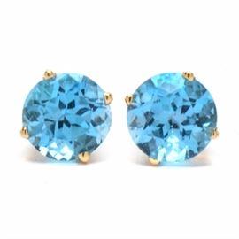 14K Yellow Gold Blue Topaz Pierced Earrings: A pair of 14K yellow gold blue topaz stud pierced earrings comprising four-prong set 7.00 mm round cut blue topaz gemstones.