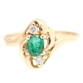14K Yellow Gold, Emerald and Diamond Ring: A 14K yellow gold, emerald and diamond ring.