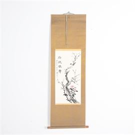 Korean Watercolor and Ink Painting on Rice Paper Mounted to Silk Hanging Scroll: A decorative Korean hanging scroll. The piece features a watercolor and ink painting on rice paper depicting a small bird resting on the branches of a cherry blossom tree, with Korean calligraphy and a red seal along the left margin. The paper is mounted to a gold tone and grey patterned silk scroll with wooden handles to the lower end. It includes a decorative hanging string to the top, with a pen notation in Korean to the verso.