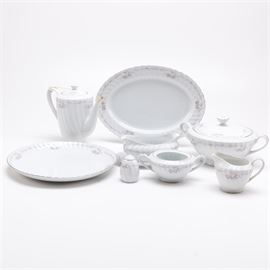 "Gold Standard Serveware: A selection of Gold Standard serveware. This selection includes eleven pieces with a pink and gray floral design and silver tone trim. The base of each piece is marked ""Genuiine Porcelain China Gold Standard Made I Japan"" to the base."