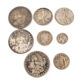 Assorted Silver Coins: An assortment of silver coins. Included in this assortment are a Liberty dime marked 1924-W, a Liberty quarter marked 1928-D M, and a barber quarter marked 1907-D. Also included are Liberty half dollars marked 1943-S, and 1939-S, and Liberty dollars from 1878, 1879, 1896.