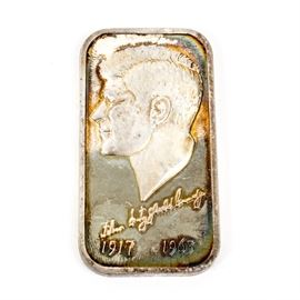 ".999 Silver John F. Kennedy Ingot: A limited edition John F. Kennedy .999 pure silver ingot from 1973. Featured here is a rectangular silver bar depicted the face of John of Kennedy on its front and the dates 1917 and 1963. The back of the bar reads ""November 22, 1973, Silver Creations Ltd, Limited Edition 4,000, Garden State Silver Company, .999 Purse Silver"". This silver bar weighs 1.000 ozt."