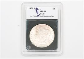 """1879-S Morgan Silver Dollar: An 1879-S Morgan silver dollar. The coin features a left facing profile of Lady Liberty on the obverse. The reverse depicts a bald eagle clutching an olive branch in one talon and a bundle of arrows in the other, surrounded by the text """"United States of America"""", """"One Dollar"""", and """"In God We Trust"""". Designer: George T. Morgan. Mintage: 9,110,000. Metal Content: 90% silver, 10% Copper. Approximate diameter: 38.1 mm. Approximate weight: 26.73 grams. Condition: Very good – circulated. Please preview for your own personal assessment."""