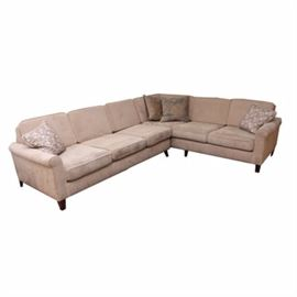 """Contemporary Sectional Couch In Beige Upholstery: A contemporary """"L"""" shaped sectional couch in beige with an understated herringbone upholstery. This two piece couch features a straight back and rolled arms with square legs and feet. This piece features a total of six areas for seating."""