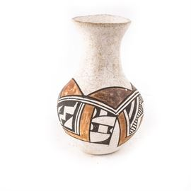 """Acoma Pueblo Pottery Vase: An Acoma pueblo pottery vase. This vase is handcrafted of clay and features flared lip above a fluted neck and bulbous body. It is decorated with a two-tone brown and black traditional motif. The vase is marked on the underside """"Acoma, N. Mexico""""."""