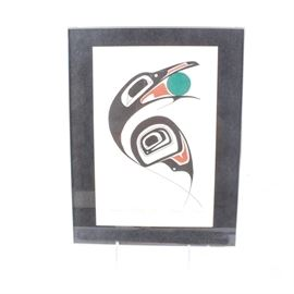 """After Danny Dennis Framed Serigraph """"Raven Stealing Sun"""": A framed serigraph titled Raven Stealing Sun after Canadian artist Danny Dennis (b.1951, Port Essington, B.C). It depicts the stylistic eagle symbolism of the native artist culture in vibrant red, teal, and black hues. It is plate signed and titled to the lower margin and set in a black mat. Presents in an acrylic frame."""