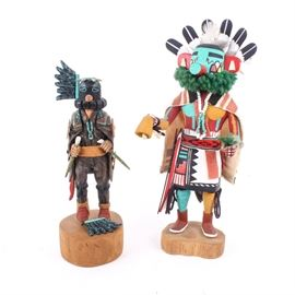 """Pair of Handmade Navajo Kachina Dolls: A pair of handmade Navajo kachina dolls. Each doll features a painted wood construction depicting two spirit dancers in ceremonial dress. One item is signed on the underside of the base, """"Crow, Lloyd Talawyma, Moencopi, AZ"""", and the other is marked """"WILPOLEYESTEWA, TALAVI""""."""