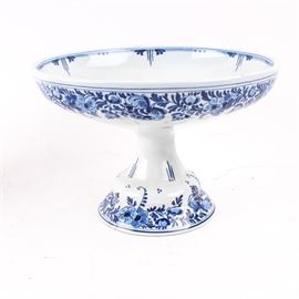 """Antique Delft Porcelain Footed Compote: An antique Delft porcelain footed compote. This compote is decorated with a hand painted floral and foliate motif expressed in blue shades. It is marked """"Delft"""" to the interior of the base."""