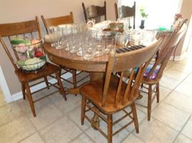 wonderful claw foot table, oak, with 6 pressed back chairs