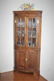 Antique corner china cabinet with original key