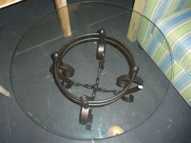 Glass top round coffee table with bronze base.