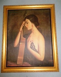 Unique oil of a senorita with her guitar.  Beautiful wooden frame with carved border and finished in gold.
