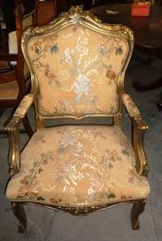 Pretty flora accent arm chair with solid mahogany frame finished in gold.