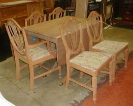 1940's drop leaf dining table and five chairs, finish has been striped. $45.00