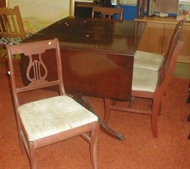 Small 1940's dining table and four chairs.  $40.00