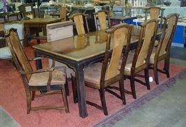 Asian Style Dining table and seven chairs.  $110.00