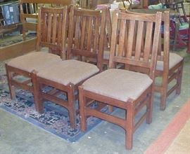 six contemporary Mission style dining chairs.  $65.00