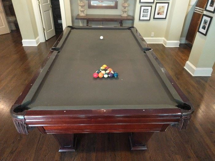 "9' ""Ventura"" pool table, by Brunswick.                    Outside dimension 60"" x 110"", Playing area 50"" x 100"", Shipping weight, 927 pounds.                               Features include: traditional regulation size leather net pockets, 3-piece precision ground 1"" full size slate, solid mahogany rails with pearlized inlaid sights."