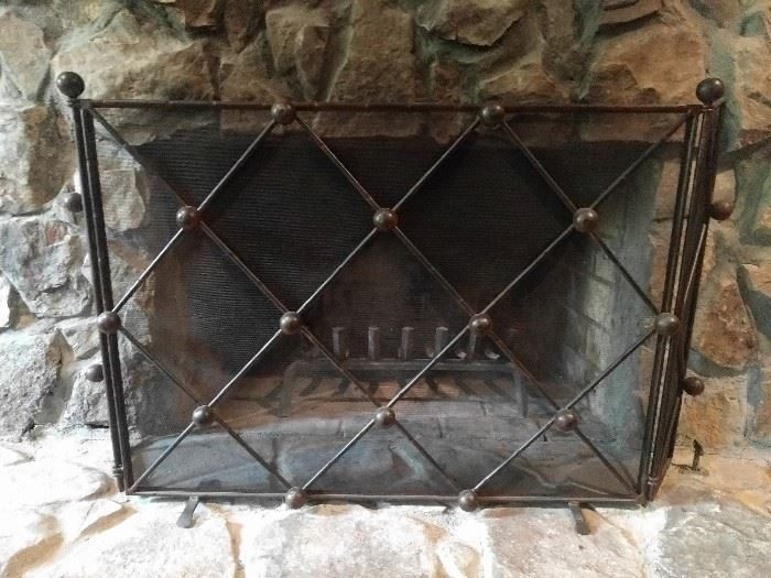 Quite substantial wrought iron fire screen. Please remove before baking cookies for Santa.                      He doesn't like boundaries when he pops in for a quickie.