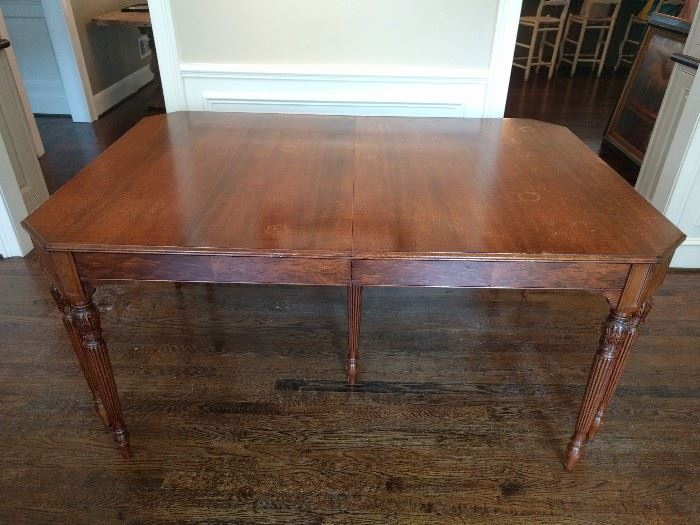 "Vintage Landstrom mahogany dining table, with two gated leaves; measures 3' 7"" W x 5' 4"" long x 30"" T, leaves are 11"" wide."