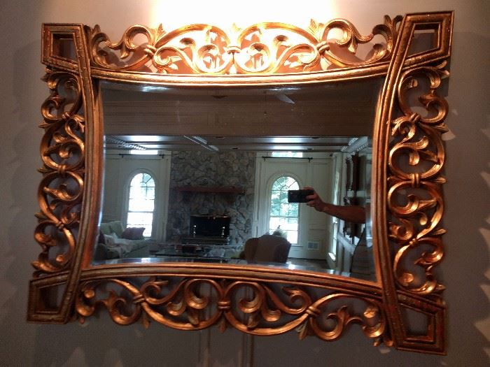 "Large gilt, beveled mirror, measures 4' 1"" x 3' 2""."