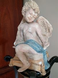 Vintage chalk figure of an angel admiring her new engagement ring.                                                               He must have gone to Jared's...