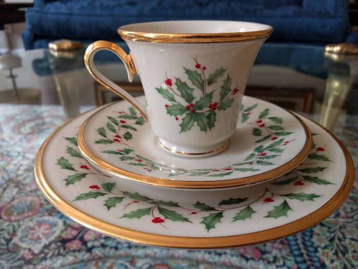 "Timely 24-piece set of Lenox  ""Holiday"" china, includes dessert plates, cups and sassy saucers.                      You have to bake your own cookies to lure that hot Santa to your warm chimney."