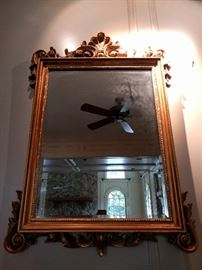 "Large gilt mirror, with beveled glass, Diamond View, by Sterling Industries; measures 3' 10"" x 2' 7""."