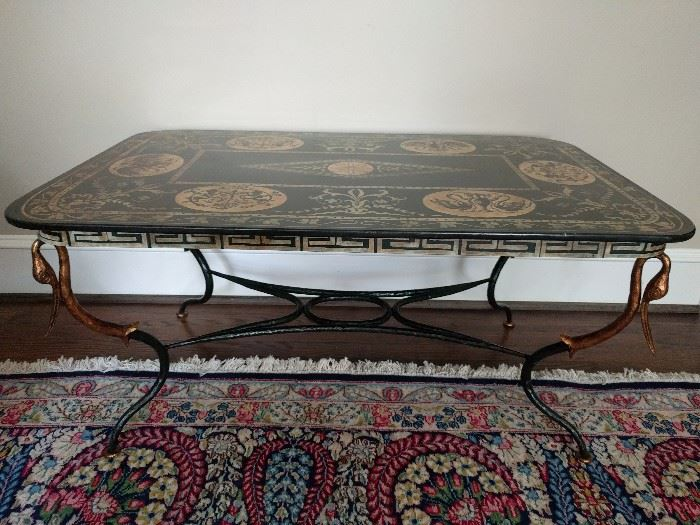Gorgeous and unique 19th Century cast iron coffee table, with hand painted top and gilt swan head atop each leg.